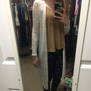 Cream Long line cardigan with fringe bottom